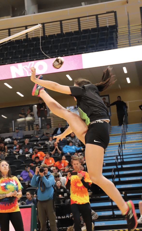 Allie Ivanoff leaping in One Foot High Kick